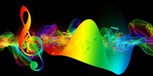 bunte Noten und Klangwellen vor schwarzem Hintergrund